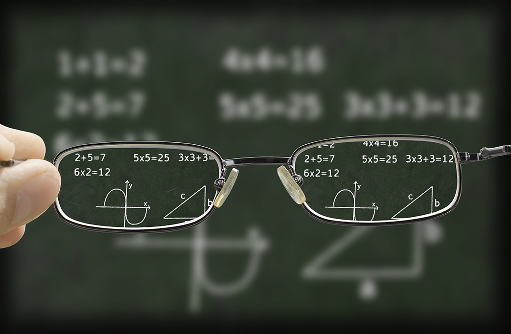 blurry vision of a green chalkboard with mathematic calculation on it corrected by the glasses